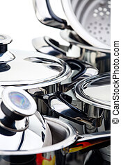 Stainless steel pots - A fragment of a still life of chrome-...