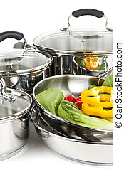 Stainless steel pots and pans with vegetables - Stainless...