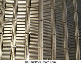 Stainless steel silo exterior.