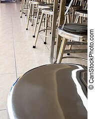 Stainless steel stool in school cafeteria
