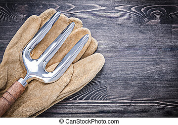 Stainless trowel fork leather safety gloves agriculture concept