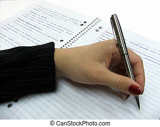 Hand in suit holds pen, writing on lined paper in spiral bound notebook - could be business or student