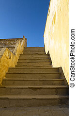 Stair case with yellow and white walls