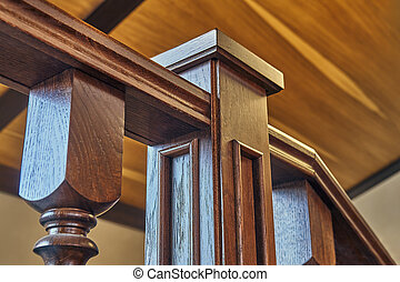 Stair pillar close-up. Wooden railing of classic staircase in modern house