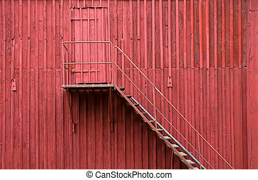Staircase and door on red wall