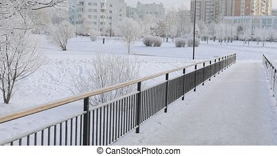 Staircase and metal fence in winter - Snow-covered metal...