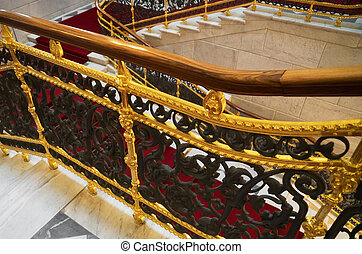Staircase and red carpet in the palace.