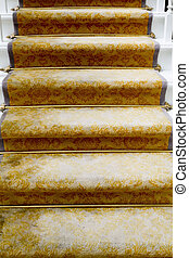 Staircase covered with luxury gold carpet