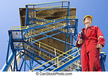 Staircase - Engineer, wearing overalls, safety goggles and a...