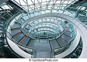 Shot from above of very long elliptical stairway