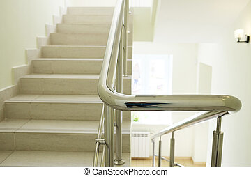 Staircase in modern building. Closeup stainless steel handrails.