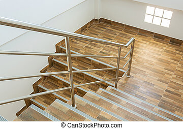 staircase in residential house with stainless steel...