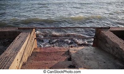 Staircase leaving the sea, embankment. - Staircase leaving...