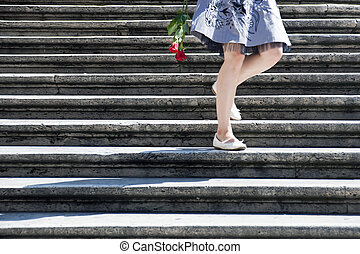 Staircase romance - Young woman decending from the Spanish...