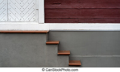 Staircase to a white wooden door