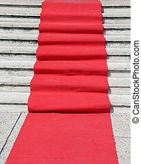staircase with a red carpet to welcome VIPs
