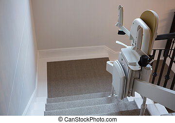 Stairlift on railing - Close-up of stairlift on railing