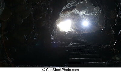stairs and exit from the underground cave, a light in the...