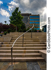 Stairs in a park and highrises in downtown Asheville, North Caro