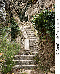 Stairs leading to he entrance of an old stone house