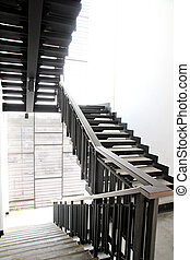Stairs made ??of black wood.