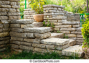 stairs made of stone on a green lawn