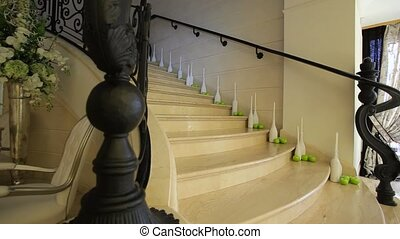 Stairs of a modern building with decorations like apples and vases in corners