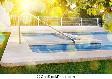 Stairs of a swimming pool in garden