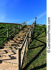 stairs to the beach with wooden railings