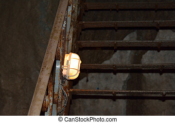 Stairs with a lamp in the cave