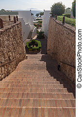 Stairs with steps leading to the sea at luxury hotel
