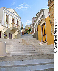 Stairway in old greek city - Steps of alleyway leading...