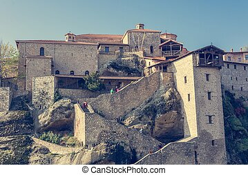 Stairway leading into a monastery build on a rock. - Holy ...