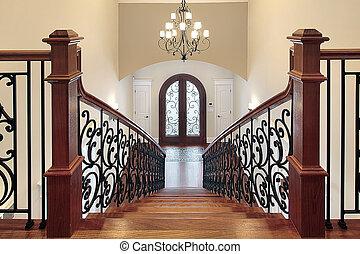 Stairway leading to foyer - Elaborate stairway leading down ...