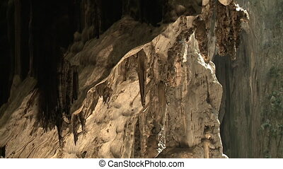 Stalactite in Batu Caves - Handheld, medium close up shot of...