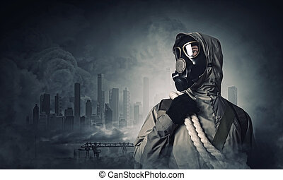 Stalker in gas mask - Man in gas mask against disaster...
