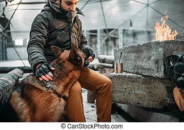 Stalker, post-apocalypse soldier feeding a dog. Post...
