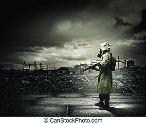 Stalker with gun - Man in gas mask and camouflage holding ...