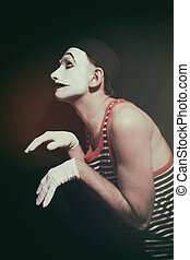 Stalking actor mime on a black background