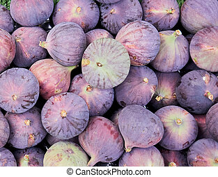 Stall in the market with a lot of figs. Close up.