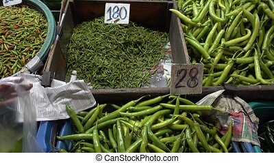 Stall selling Chili green pepper market Asia - Stall selling...