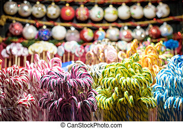 Stall with traditional colorful and festive candies at the Christmas Market in Vilnius in Lithuania. Candies are very popular at such markets. Selective focus