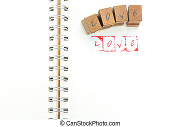 Stamp alphabet with the word LOVE and Stamping blocks