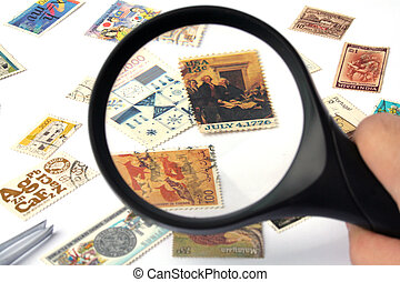 Magnifying glass over a US stamp; focus on the stamp