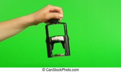 Stamp on a green background. Close up. Green screen