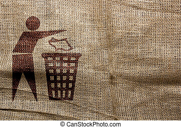 Stamp on sackcloth, throw away the trash. Industrial symbolism.