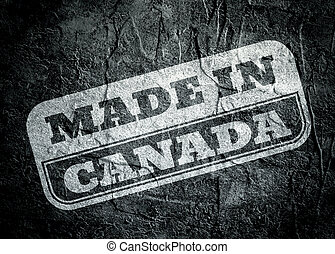 Stamp with made in Canada text over grunge background