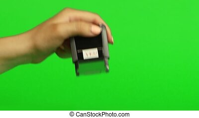 Stamp yes on a green background. Close up. Green screen