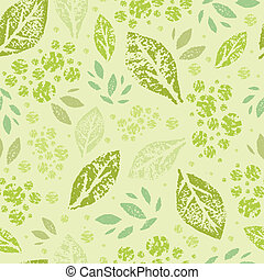 Vector stamped green leaves seamless pattern background with abstract plants with fun leaves and branches forming a floral texture.