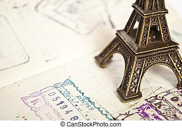 Stamped passport with Eiffel passport - travel to Paris concept